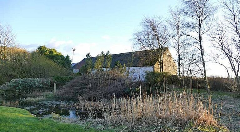 Picture of the pond and garden in front of The Swallow Theatre